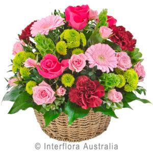 basket arrangement in pinks...$70