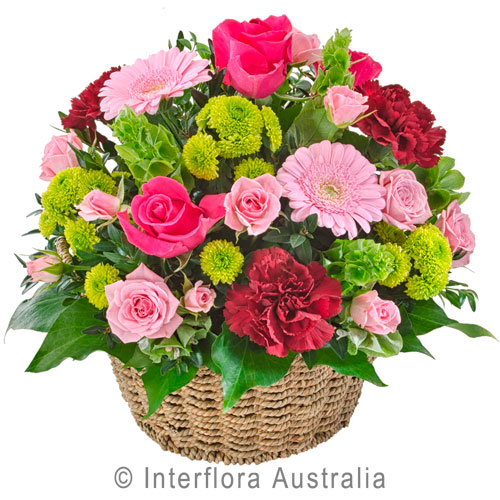 basket arrangement in pinks...$70